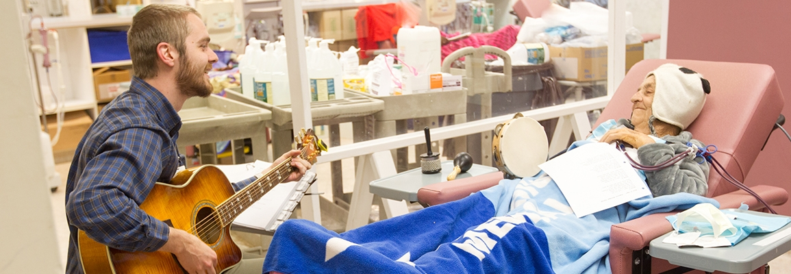 music therapy student and elderly patient