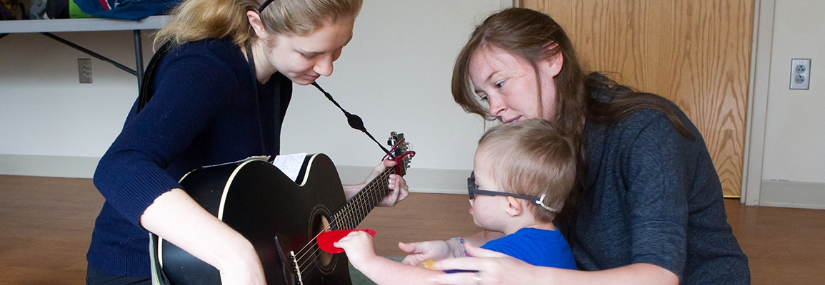 music therapy students and toddler