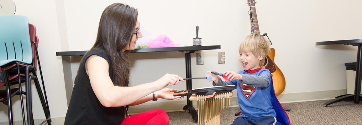 Music Therapy student and child