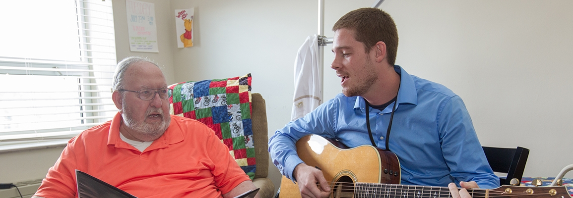 music therapy student and hospital patient